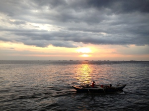 A fishing boat at sunset on the coast of Manila.
