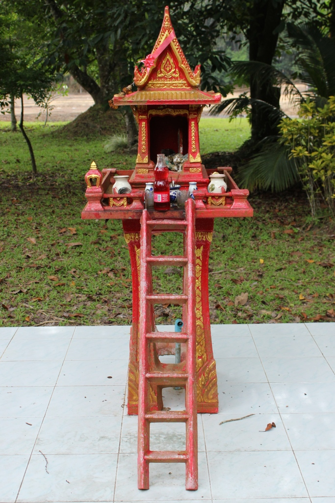 "In Thailand, ""spirit houses"" are small shrines that can be seen at many homes, businesses, and establishments. It is prominently placed on the premise as a shelter for a spirit or spirits, and should be fitted with a small offering. Spirit houses are supposed to ensure that the Guardian or Protector of the House and/or Business (often in the same building) watches over and protects the property and people. It's believed that spirits may be good, evil, or just unpredictable and mischievous, being capable of causing disaster, harm or the failure of a business if neglected and not appeased."