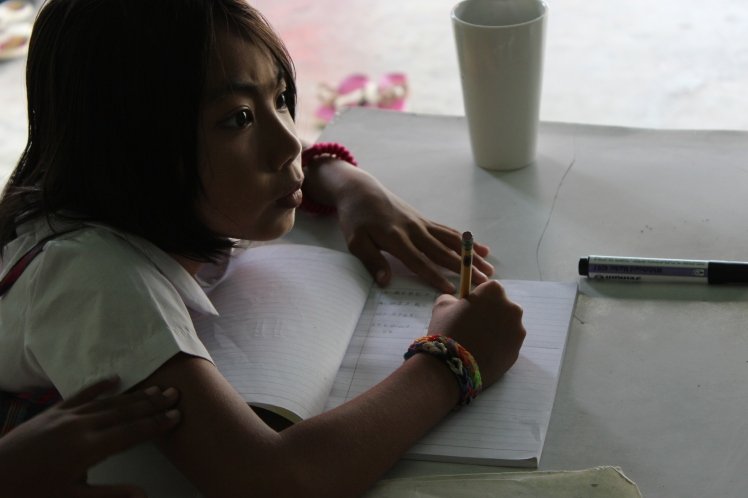 One of the Burmese students working on schoolwork.