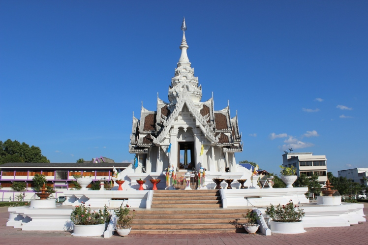 "The City Pillar Shrine, in the center of Phayao. It's dedicated to the many spirits of the area.  ""A Lak Mueang or City Pillar Shrine (as it is known in English) is a Thai public shrine, which is or represents the tutelary diety of each province of the Kingdom. Essentially, the shrine represents 'good luck' and acts as a guardian for the good fortune of the region. The shrine consists of a central pillar, which is housed in a enclosing structure. This structure usually reflects the historical and cultural background of the province. Each Shrine has great religious, social, and political importance, and are held in high regard by the local inhabitants. Before each shrine is a 'prayer area', where locals and visitors can come by and make an offering to the shrine, ask for assistance, and ask for good fortune in their lives and the lives of their loved ones. Most Thai provinces have an official Shrine, and some districts within a province have their own, smaller shrine."""