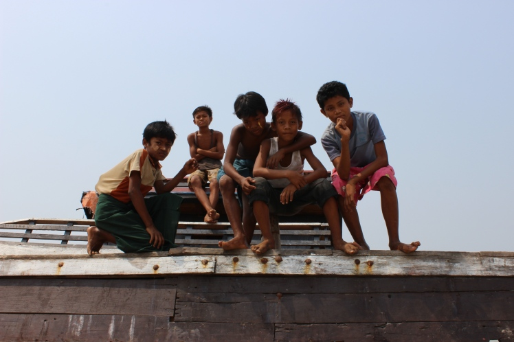 I met these boys at the local beach and spent some time playing with them. Here, they pose on an abandoned ship.