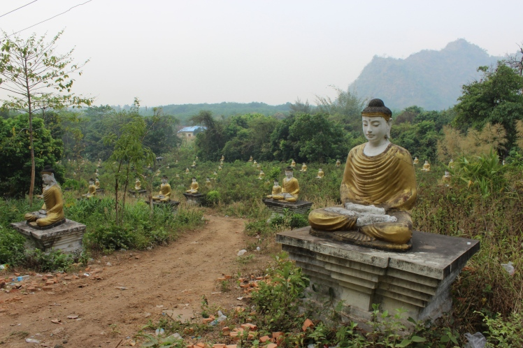 A fascinating assembly of numerous Buddha statues at the foot of Mt. Zwegabin.